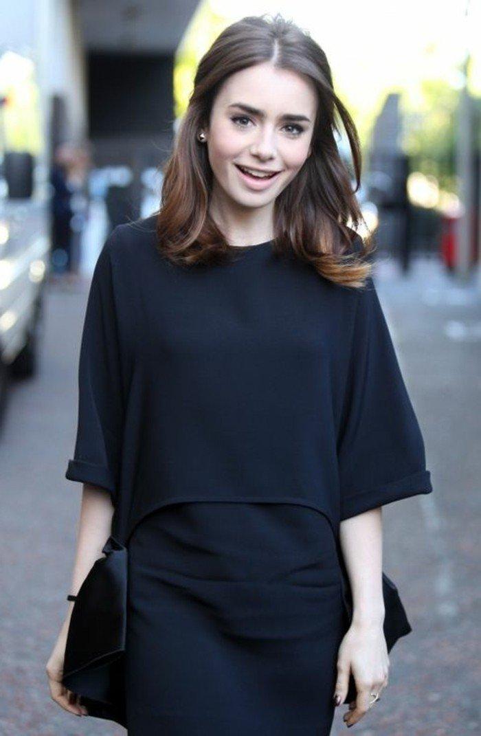 braune haare und ein nettes aussehen, elegante frau in schwarz, mittellange haare, kleine ohrringe