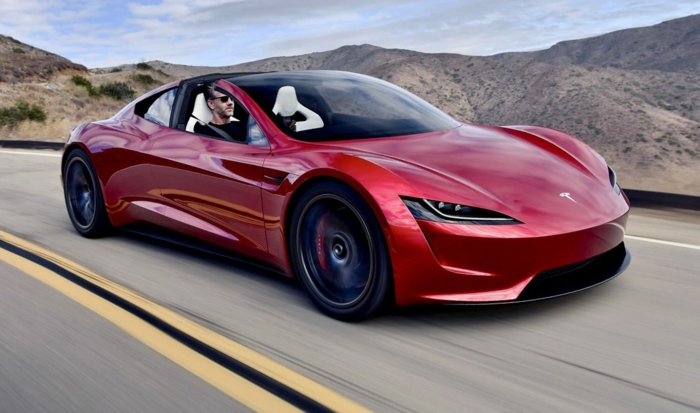 Roadster, ein rotes Auto, das vielleicht ein fliegendes Modell bekommt auf der Autobahn