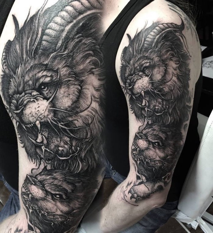 große bestie, tattoos männer arm, schwarz graue tätowierung am oberarm