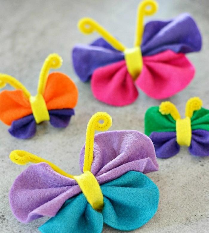 basteln Kindergeburtstag Deko Ideen, kleine bunte Schmetterlinge aus Stoff machen und sie auf Vorhänge und Fenster aufkleben oder anhängen