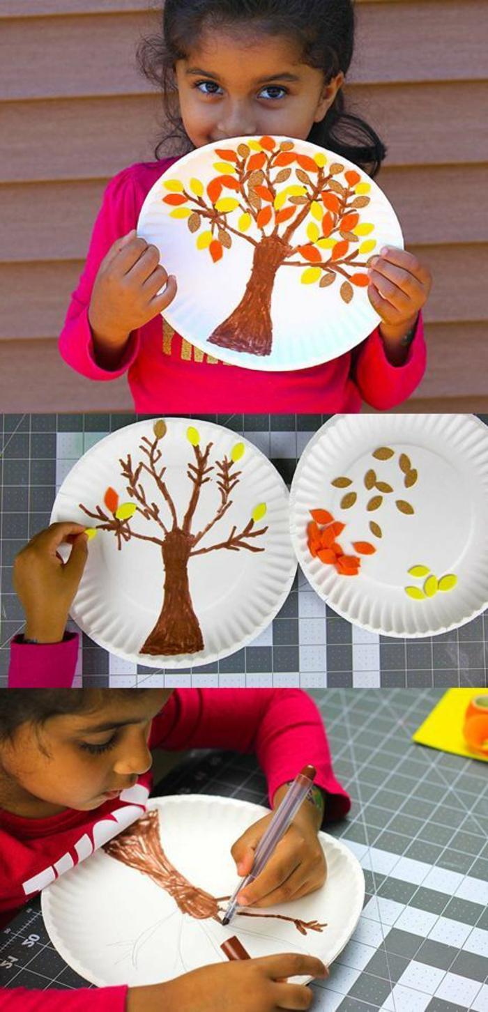 Coole Bastelideen, ein Mädchen hält einen Pappteller, auf den es Baum gemalt hat, schöne Dekoideen Kinder basteln