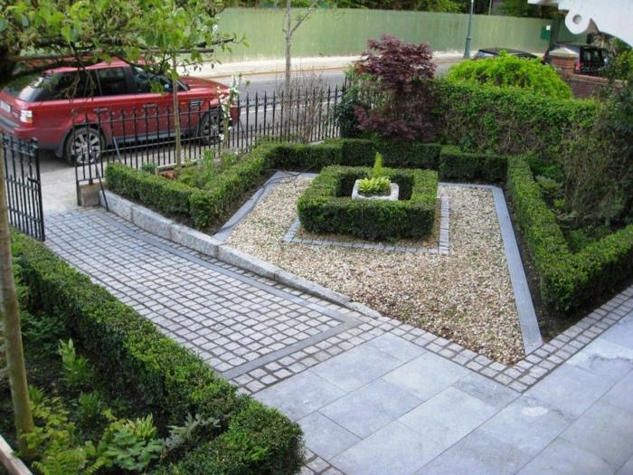 Kies Steine, eine niedrige Hecke, grauer Stein, ein niedriger Zaun, Vorgarten modern, ein rotes Auto