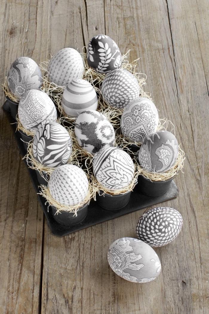 viele eier dekoriert in weiß und grau, osterkörbchen selber basteln, ostern ideen