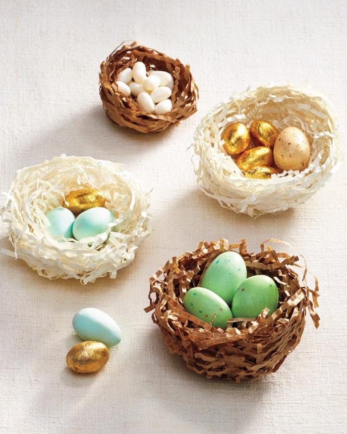 selsbtgemachte neste aus papier, osternest selber basteln, eier dekoriert mit blattgold