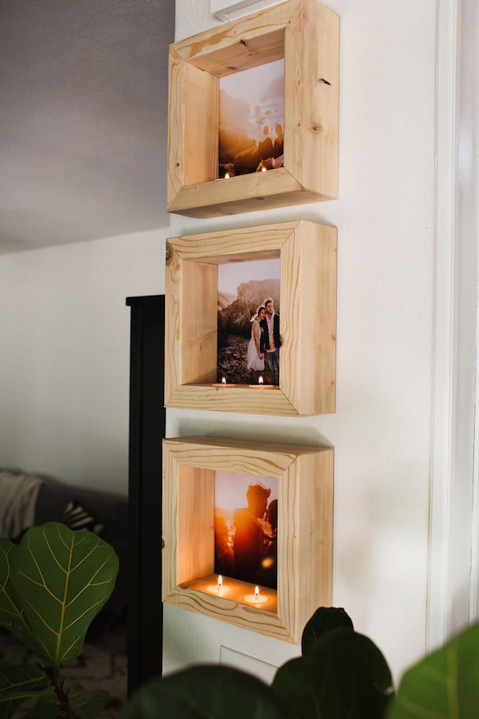 Selbstgemachte Bilderrahmen aus Holz mit Teelichtern, kreative Wanddeko selber machen