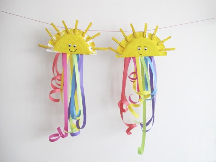 basteln Kindergeburtstag Dekorationen und Ideen, Pinata selber machen, kleine Sonnen aus Teller machen und mit buntem Papier verzieren, Regenbogen Muster
