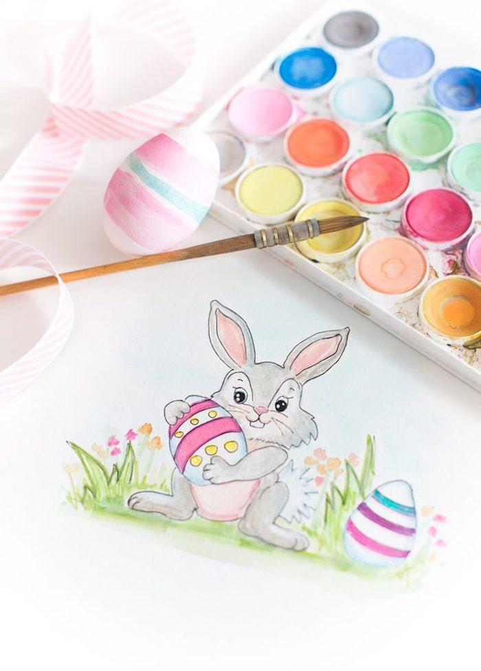 Osterbasteln mit Kindern, Osterhase und Ostereier mit Wasserfarben malen