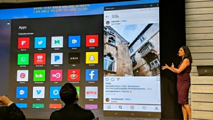 Eine Frau erklärt das neue Update von Your Phone App, Bildschirm spiegeln