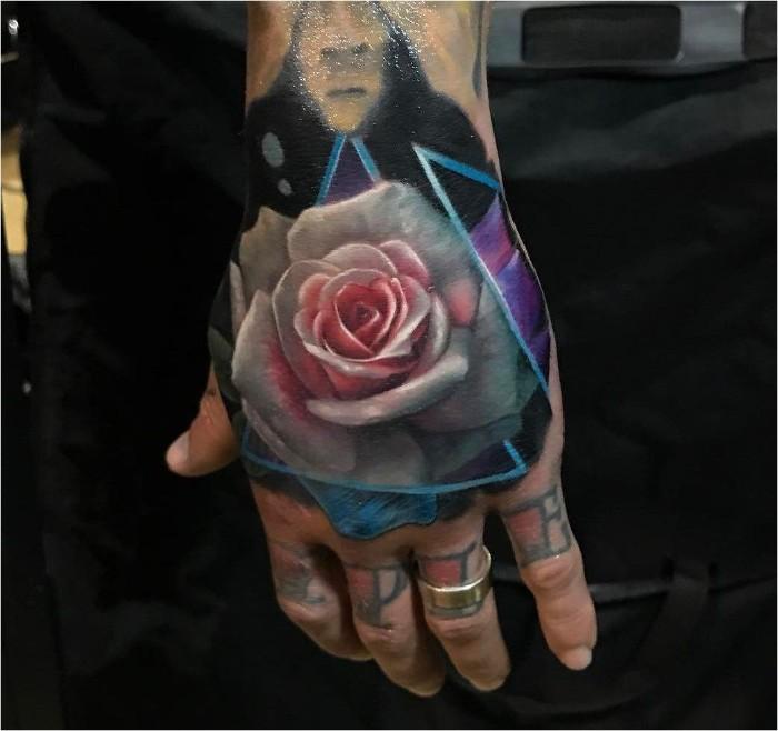 blume des lebens tattoo, eine handtattoo mti rose, die rosen als symbole des lebens und der neuen möglichkeiten