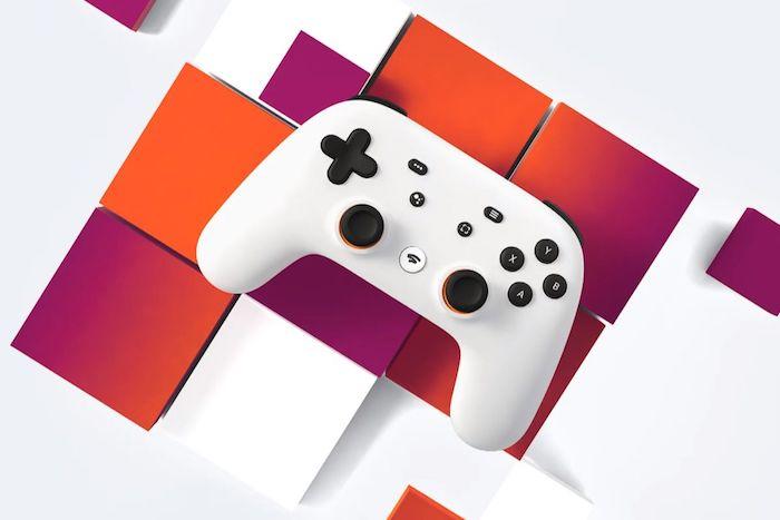 gamepad für gestreamte spiele, ein weißer controller für stadia mit vielen kleinen schwarzen knöpfen
