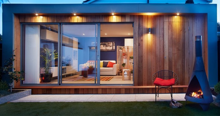 Gartenhaus groß in perfekter Stil, ein zweites Wohnzimmer im Garten haben ist der Traum von vielen Menschen, Kamin im Garten