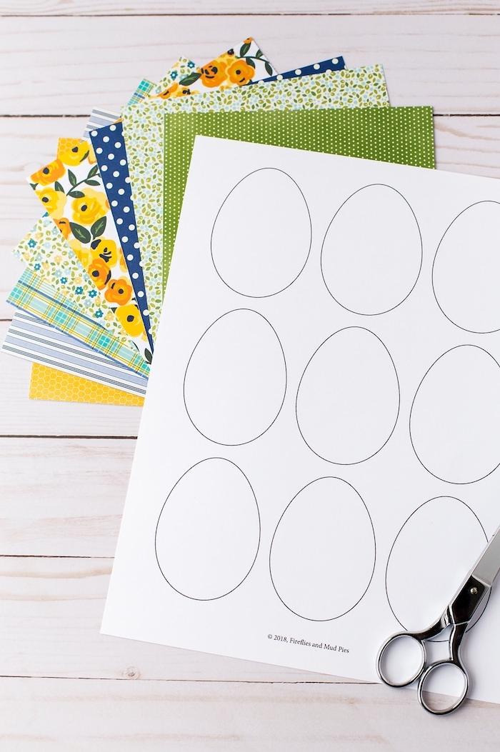 Ostereier aus Papier selber machen, Materialien dazu, buntes Papier, Schere und Vorlagen, Osterbaum schmücken