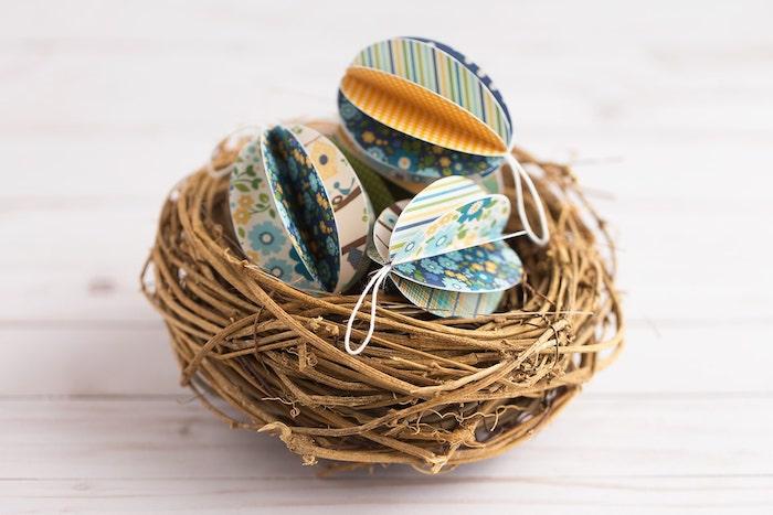 3D Ostereier aus buntem Papier in Osternest, schöne DIY Deko zu Ostern mit Anleitung