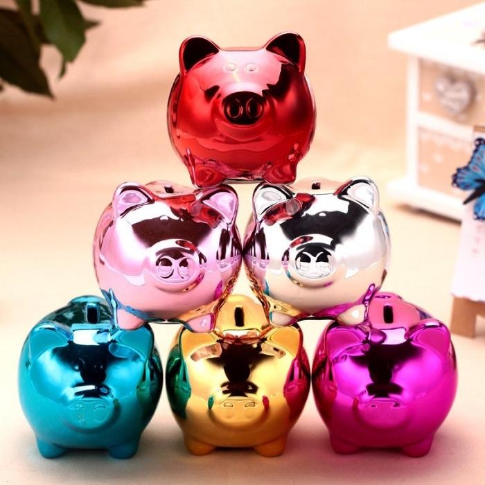 sparschwein groß, viele schweine in chrome look, geld sparen, geldboxe
