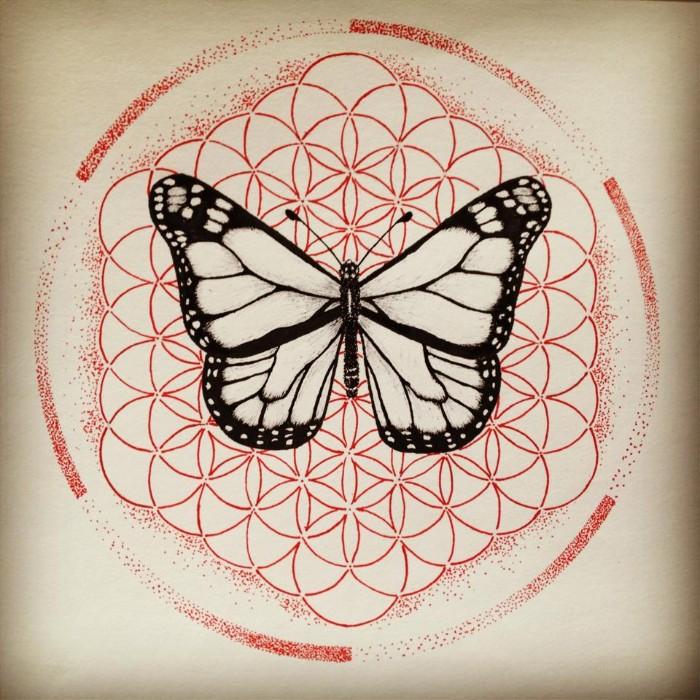 tattoo bedeutung ein schmetterling auf dem symbol der lebensblume, leben und neugeburt
