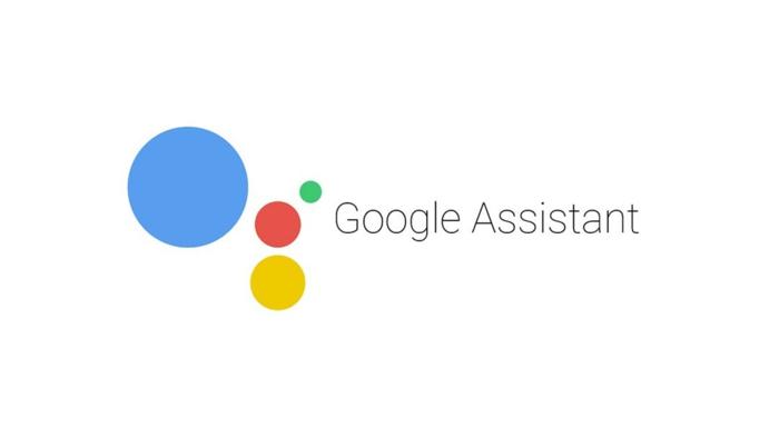 ein Logo von Google Assistant, ein großer blauer Kreis, kleine bunte Kreise, der Name mit schwarzen Buchstaben