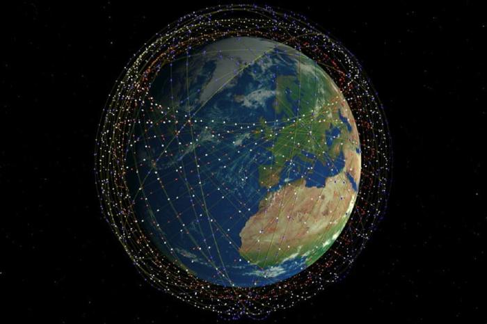 die Erde mit vielen Satelliten die in Erdeorbit kreisen, Silicon Valley will die Welt erobern