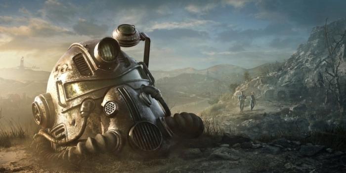 eine Maske in dem Ödland und zwei Held im Hintergrund, eine Szene aus Fallout 76