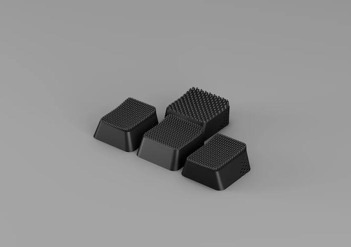 die Uppkoppla Linie von dem Unternehmen Ikra, vier kleine schwarze 3d-gedruckte tastenkappen