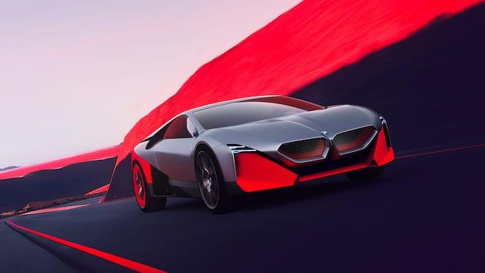 weg und grauer wagen, das neue elektroauto von bmw namens bmw next m vision