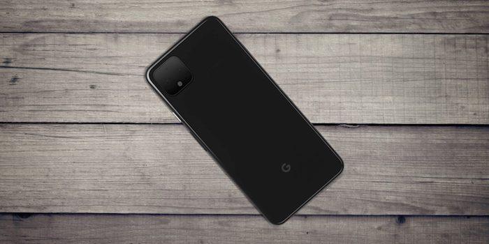 tisch aus holz und ein kleines schwarzes smartphone google pixel vier mit sensoren und einer schwarzen kamera