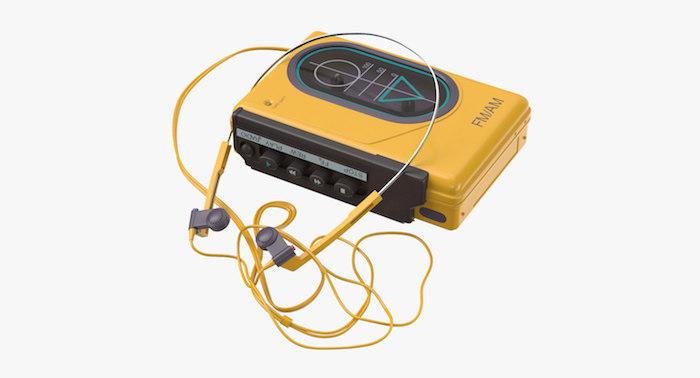 ein gelbes kleines gerät zum musik hören mit gelben kopfhörern, ein gelber walkman von sony