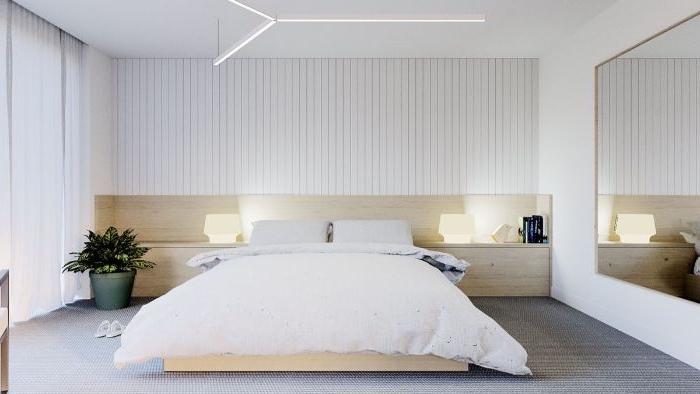 minimalistisch leben, ein dezentes design, doppelbett, riesengroßer spiegel, pflanze auf dem boden