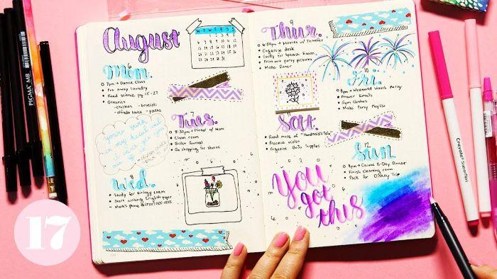 bullet journal key deutsch, rosa hintergrund, heft mit farben und lustige bilder gestalten