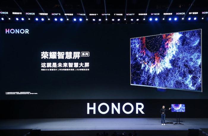 ein bunter großer smart fernseher mit violetten bildschirm, der honor vision pro