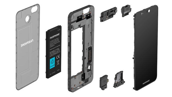 das smartphone fairphone 3 mit vielen kleinen austauschbaren modulen, eine schwarze batterie