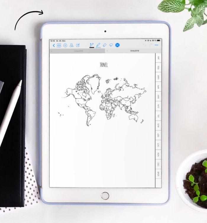 bullet journal ideen januar, tablett mit ein bild von der erde darauf, weißes ipad