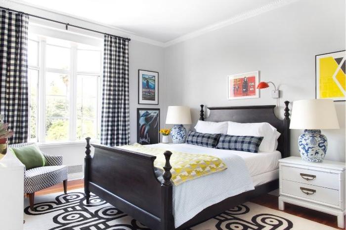 schlafzimmer mit boxspringbett, ein klassisches design mit kreativen elementen als deko und farben