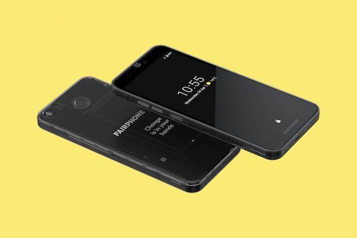 handy mit einem schwarzen bildschirm, zwei schwarze smartphones mit vielen kleinen austauschbaren modulen und zwei kameras