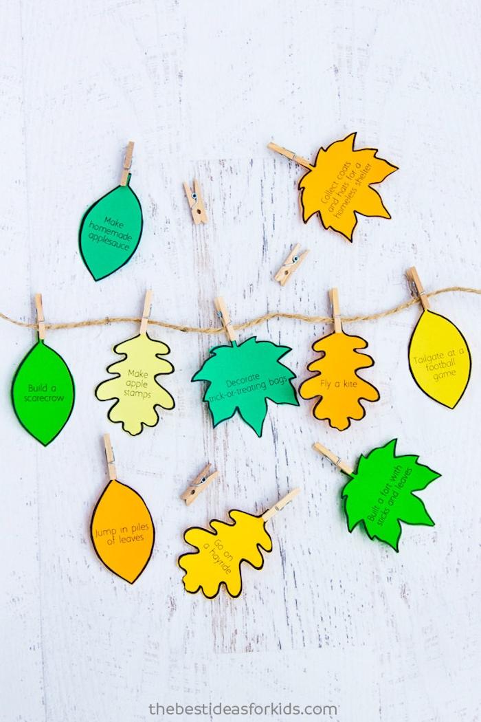 Girlande mit bunten Herbstblättern aus Papier selber machen, Herbstblätter mit Herausforderungen