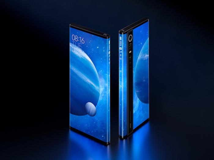 ein bildschirm mit blauen planeten und sternen, zwei smartphones xiaomi mi mix alpha mit rundum displays