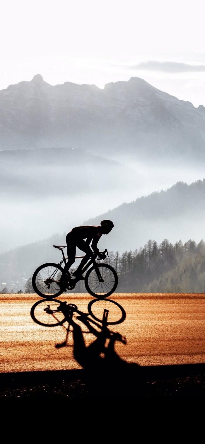 apple iphone wallpaper, hintergrundbild frei herunterladen, mann mit fahrrad, gebirge