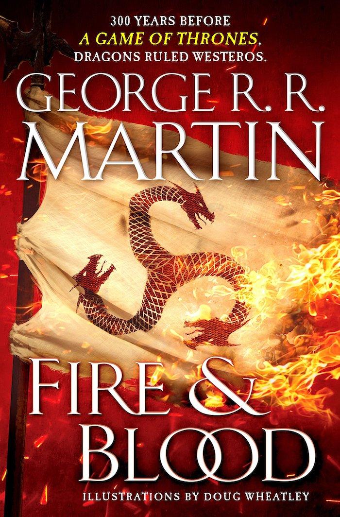 das buch fire and blood von dem autor george r r martin, eine große fahne mit feuer und mit drei roten drachen