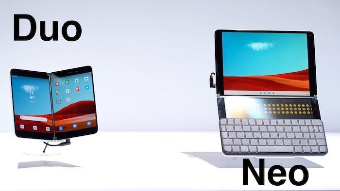 ein tablet mit einer grauen tastatur und mit bildschirm mit blauem himmel und wüste, ein kleines smartphone surface duo mit zwei bildschirmen