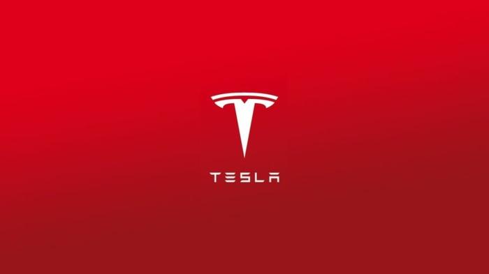 Tesla Aktien steigen, ein Logo von der Firma in roter Farbe mit weißen Buchstaben