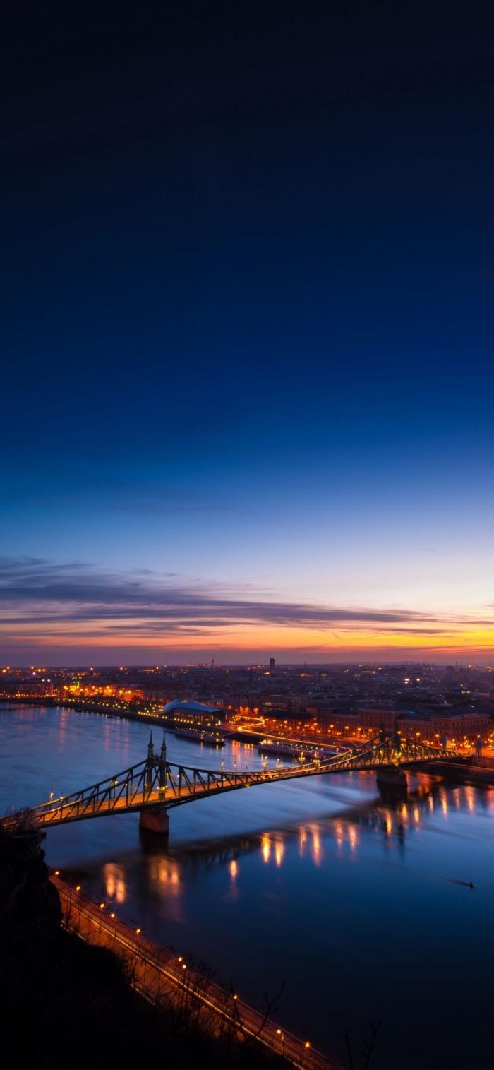 iphone x hintergrund, großer fluß mit brücke, stadt fotografiert vom himmel, sonnenuntergang