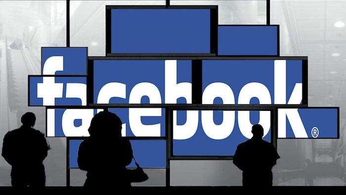 das logo von dem sozialen netzwerk facebook und menschen