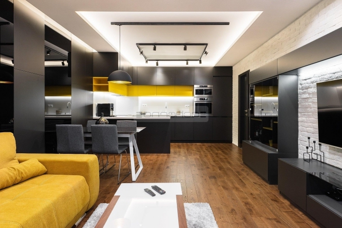 wohnzimmergestaltung in weiß und schwarz, gelbe farbakzente, wohnzimmer einrichten farben