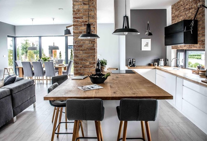wohnzimmer gestalten tipps, großer esstisch aus holz, wände in ziegeloptik, küche einrichten