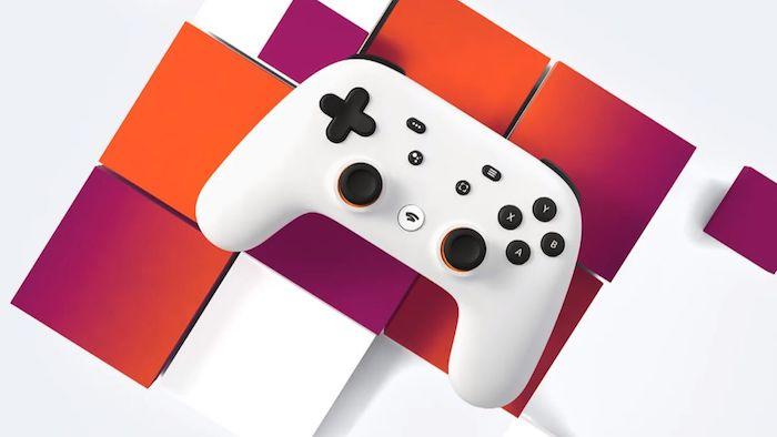 ein großer weißer joystick mit schwarzen tasten, der neue streaming dienst für spiele stadia von google