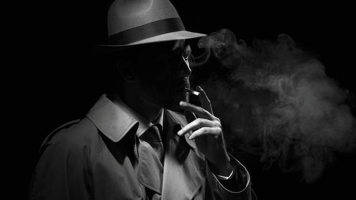 mann mit hut, ein Privatdetektiv