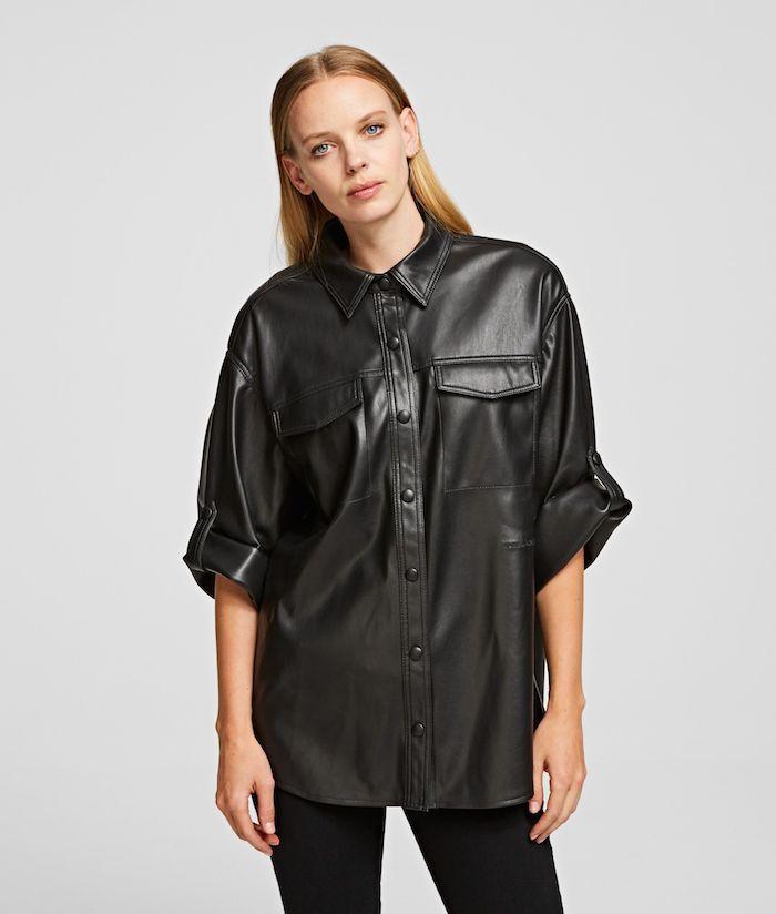 frau mit schwarzem hemd aus leder