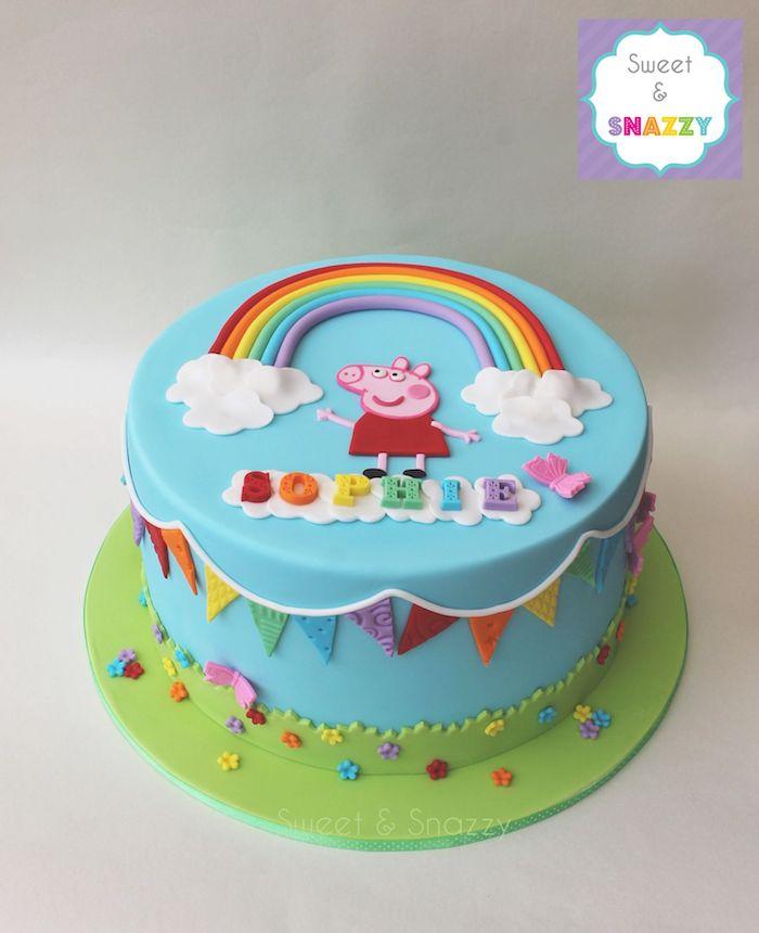 Peppa Wutz Fondanttorte, Regenbogen und zwei kleine Wolken , Peppa und Name des Geburtstagskindes mit bunten Buchstaben
