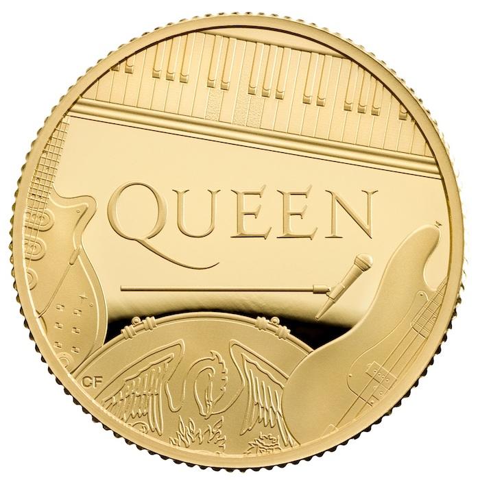 eine münze mit einer goldenen gitarre und mit dem logo von der britischen rock band queen, eine goldene münze