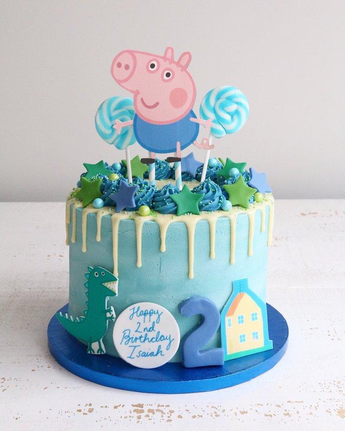 Blaue Geburtstagstorte mit Schorsch, Peppa Wutz Bruder, blaue und grüne Sterne und Lutscher, Schorsch Figur