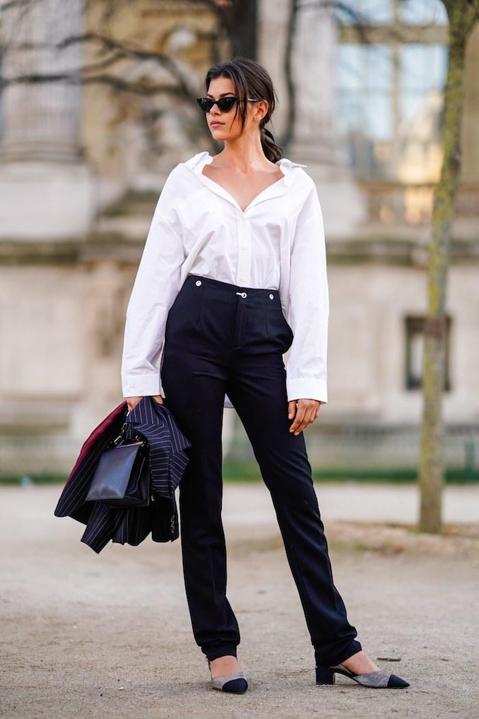 Modetrends Frühjahr 2020, klassisches weißes Hemd, schwarze Hose mit hoher Taille